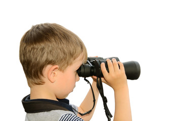 little boy looking through binoculars at sea. side view, isolate