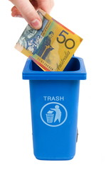 rubbish bin with money