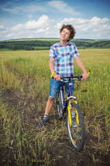 Portrait of a boy with a bicycle