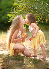 portrait of two sisters in tropical style