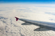 Fluffy clouds and airplane wing
