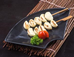 japanese cuisine. japanese bbq garlic on the background