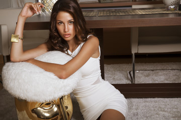 elegant lady in white dress in house. indoor. shot