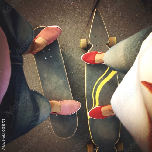 a boy's and girl's legs on boards