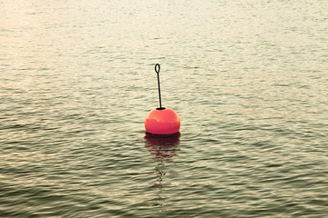Bouy by the lake - Red bouy on a calm lake