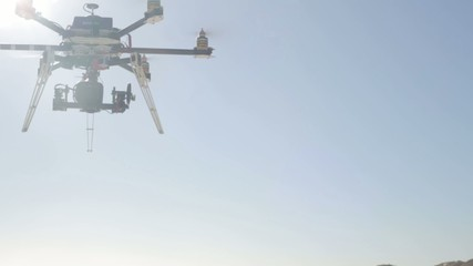 Camera Drone Flying in the Sun