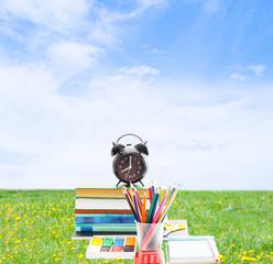 school supplies on a green lawn