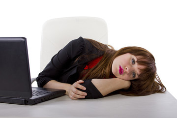 sleepy young businesswoman at work being lazy or overworked