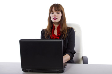 young businesswoman working on a desk with a computer