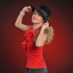 beautiful woman in red and black hat