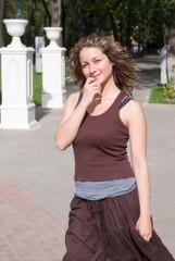 Attractive girl in city park