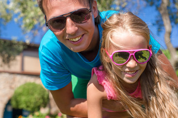 Portrait of father and little daughter at tropical vacation
