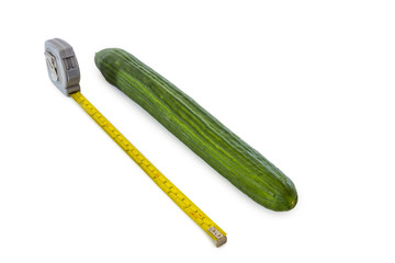 cucumber with measuring tape on white