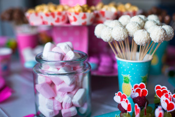 Marshmallow, sweet colored meringues, popcorn, custard cakes and