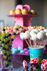 Canape of fruit, white chocolate cake pops and popcorn on sweet