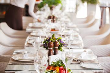 table setting in restaurant interior, desaturated