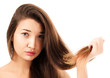woman is not happy with her fragile hair, white background, copy