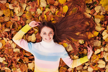 Beautiful girl at autumn. Healthy Long Hair