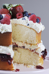Fresh whipped cream and berries sponge layer cake.