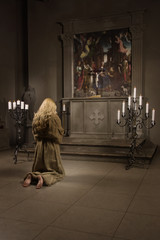 Sinner prays in a church
