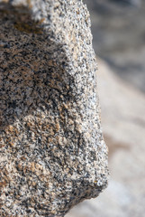 smoothed grey, red and black granite in its environment