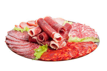 Plate with different meat delicacies isolated on white backgroun