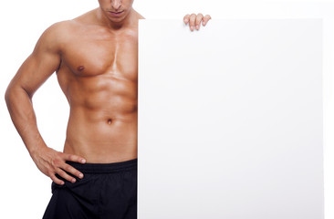 Fitness man holding a white banner
