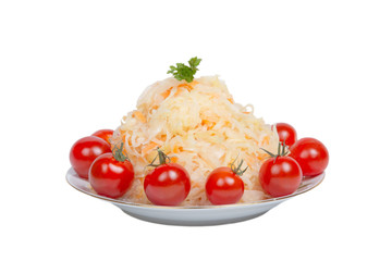 Sauerkraut with tomatoes on a plate isolated on white background