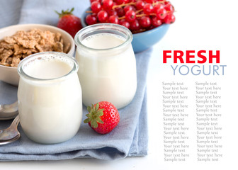 Jars of fresh natural yogurt, berries and muesli