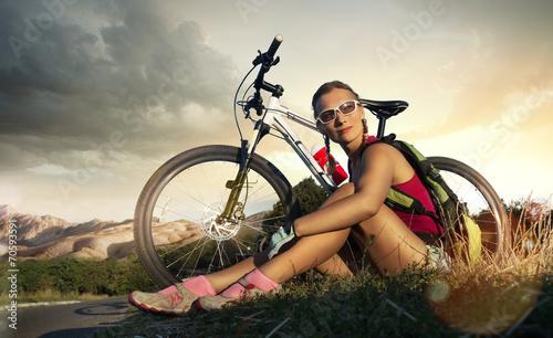 Leinwandbild Motiv Sport bike woman on a rock