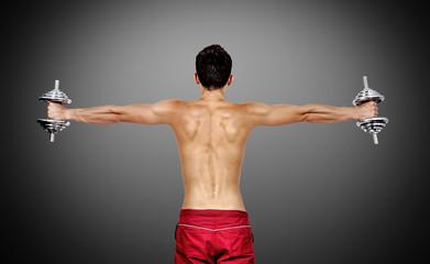 muscular man lifting dumbbells