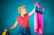 canvas print picture - Pinup girl with shopping bags buying clothes dress