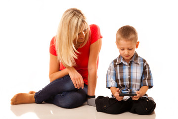Mother and son playing video game on smartphone