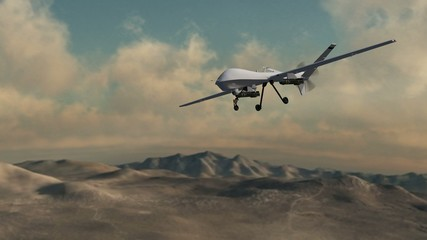 an armed drone in flight over desert - close up