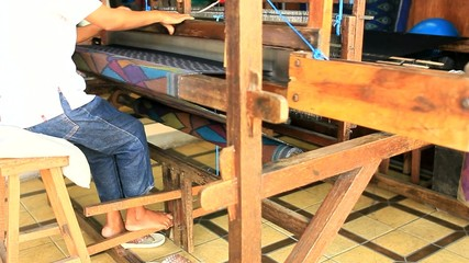 Woman Weaving Traditional Fabric in a Local Village in Indonesia