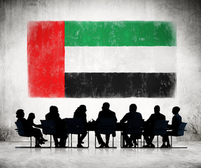 People in a Meeting with United Arab Emirates Flag