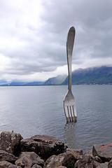 Giant steel fork in water of Geneva lake, Vevey, Switzerland