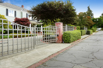Luxury real estate in Tacoma, WA. House with large entrance gate