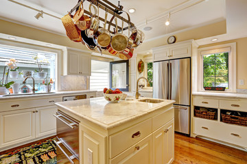 Kitchen room with island and hanging pot rack