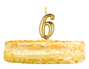 birthday cake with candles number six isolated on white