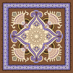 ornate floral paisley bandanna on a brown background with purple