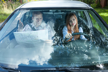 Man with map navigating woman