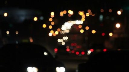 Night road. lights and silhouettes moving machines