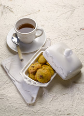 cookie with dried grape and cup of tea