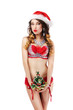 Xmas. Snow Maiden in Santa Claus Costume with Christmas Tree