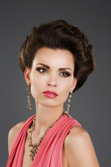 Aristocratic Lady with Glossy Earrings and Necklace