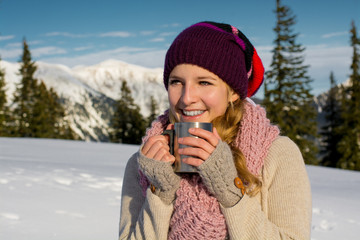 Beautiful Happy Smiling Winter Woman with Mug Outdoor.