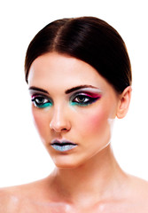 Thoughtful attractive woman with colorful makeup