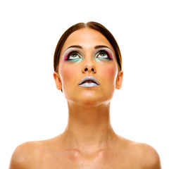 Attractive young model with bright make-up looking up