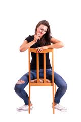 Smoking backwards sitting woman isolated